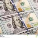 newly-minted-bills-background-new-u-s-dollar-bill-35257618
